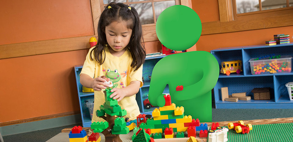 Young girl playing with building