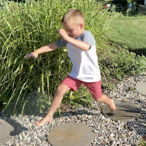 A Boy learning to jump from one step to another
