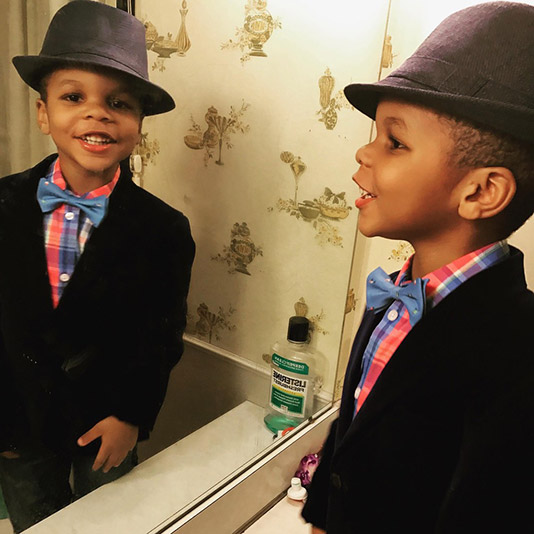 Picture of Apollo looking in a mirror, wearing a hat